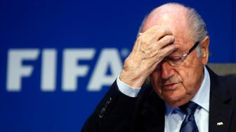 Re-elected FIFA President Sepp Blatter gestures during news conference after an extraordinary Executive Committee meeting in Zurich, Switzerland, May 30, 2015.  Blatter has been re-elected as FIFA president for a fifth term after Jordan's Prince Ali bin Al Hussein conceded defeat at the Congress of world football's governing body on Friday.   REUTERS/Arnd Wiegmann