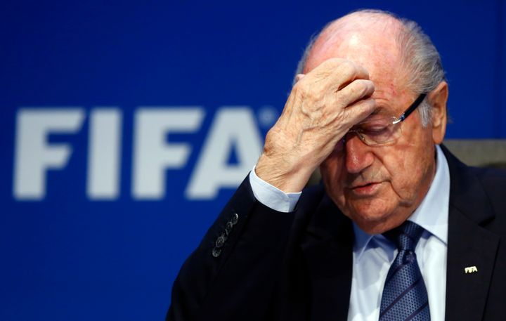 EmbattledFIFA President Sepp Blatter gestures during news conference after an extraordinary Executive Committee meeting