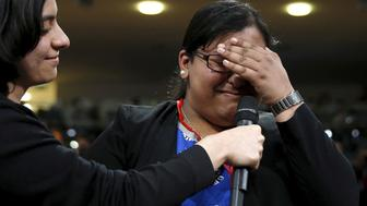 Asking a question to U.S. President Barack Obama, Maria Munir, who said she was coming out to him as a non-binary person, breaks down during a town hall held by Obama at the Royal Agricultural Halls in London, Britain April 23, 2016.REUTERS/Kevin Lamarque