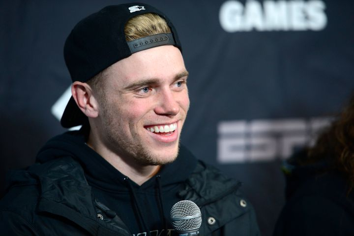 Skiier Gus Kenworthy laughs while answering a question during a press conference the day before the start of the X Games Aspe