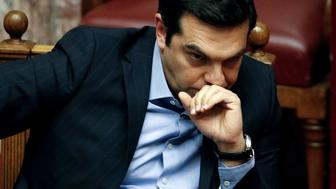 Greek Prime Minister Alexis Tsipras attends a parliamentary session before a vote for tax and pension reforms in Athens, Greece, May 8, 2016. REUTERS/Alkis Konstantinidis/File photo