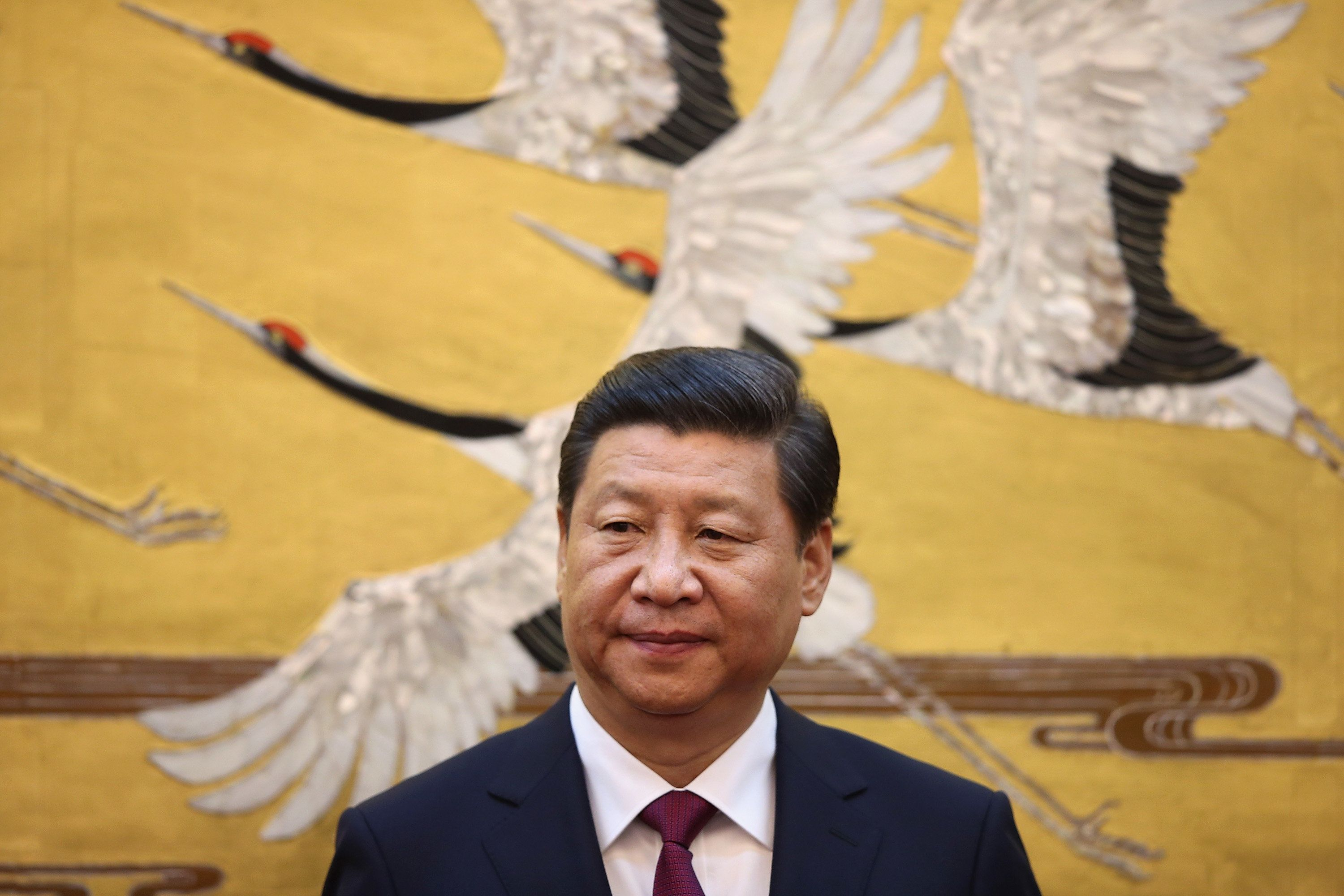 BEIJING, CHINA - SEPTEMBER 18:  Chinese President Xi Jinping attends a signing ceremony with King Abdullah II bin Al Hussein of Jordan at the Great Hall of People on September 18, 2013 in Beijing, China. At the invitation of Chinese President Xi Jinping, King Abdullah II bin Al Hussein of Jordan paid a state visit to China from September 15 to 18. (Photo by Feng Li - Pool/Getty Images)