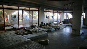 "Mattresses used by migrants are seen at the lobby of a deserted hotel on the Greek island of Kos, August 13, 2015. The United Nations refugee agency (UNHCR) called on Greece to take control of the ""total chaos"" on Mediterranean islands, where thousands of migrants have landed. About 124,000 have arrived this year by sea, many via Turkey, according to Vincent Cochetel, UNHCR director for Europe. REUTERS/Alkis Konstantinidis"