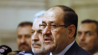 Iraq's then Vice President Nuri al-Maliki speaks during a news conference in Baghdad in this file photo taken November 29, 2014. The U.S. and Iran have formed an unlikely tacit alliance behind Iraq's prime minister as he challenges the ruling elite with plans for a non-political cabinet to fight corruption undermining the OPEC nation's economic and political stability. Local calls for Haider al-Abadi's removal -- including one by his predecessor as prime minister al-Maliki -- had been growing as he pursued a reshuffle aimed at addressing graft, which became a major issue after oil prices collapsed in 2014 and strained the government's finances as it launched a costly campaign against Islamic State.   REUTERS/Ahmed Saad/Files