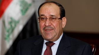 Iraq's Prime Minister Nuri al-Maliki speaks during an interview with Reuters in Baghdad January 12, 2014.  IRAQ/MALIKI   REUTERS/Thaier Al-Sudani/File Photo