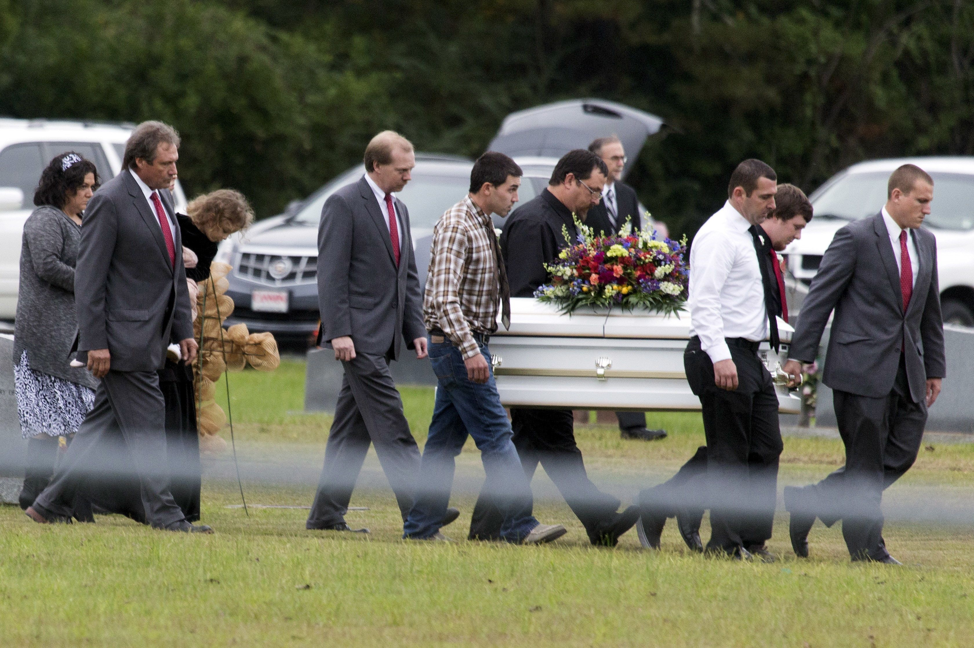 Pallbearers carry the casket of six-year old Jeremy Mardis at a cemetery in Beaumont, Mississippi, November 9, 2015.