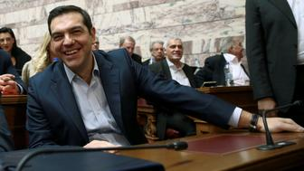 Greek Prime Minister Alexis Tsipras reacts before a ruling Syriza party parliamentary group session in Athens, Greece November 23, 2016. REUTERS/Michalis Karagiannis