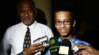 Ahmed Mohamed (R), a 14-year-old US Muslim teenager of Sudanese origin who became an overnight sensation after a Texas teacher mistook his homemade clock for a bomb, speaks to the press next to his father Mohamed Elhassan Mohamed before his meeting with Sudanese President Omar al-Bashir, in Khartoum on October 14, 2015.  The son of Sudanese immigrants who live in a Dallas suburb, the young robotics fan brought in a home-made clock to impress a new teacher at MacArthur High Schoo was taken away from school in handcuffs and briefly arrested by police. Police later said they have determined that Mohamed had no malicious intent and it was 'just a naive set of circumstances.' AFP PHOTO / ASHRAF SHAZLY        (Photo credit should read ASHRAF SHAZLY/AFP/Getty Images)