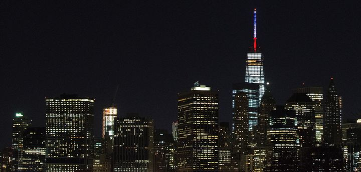 One World Trade Center's spire is shown lit in French flags colors of white, blue and red in solidarity with France after ton