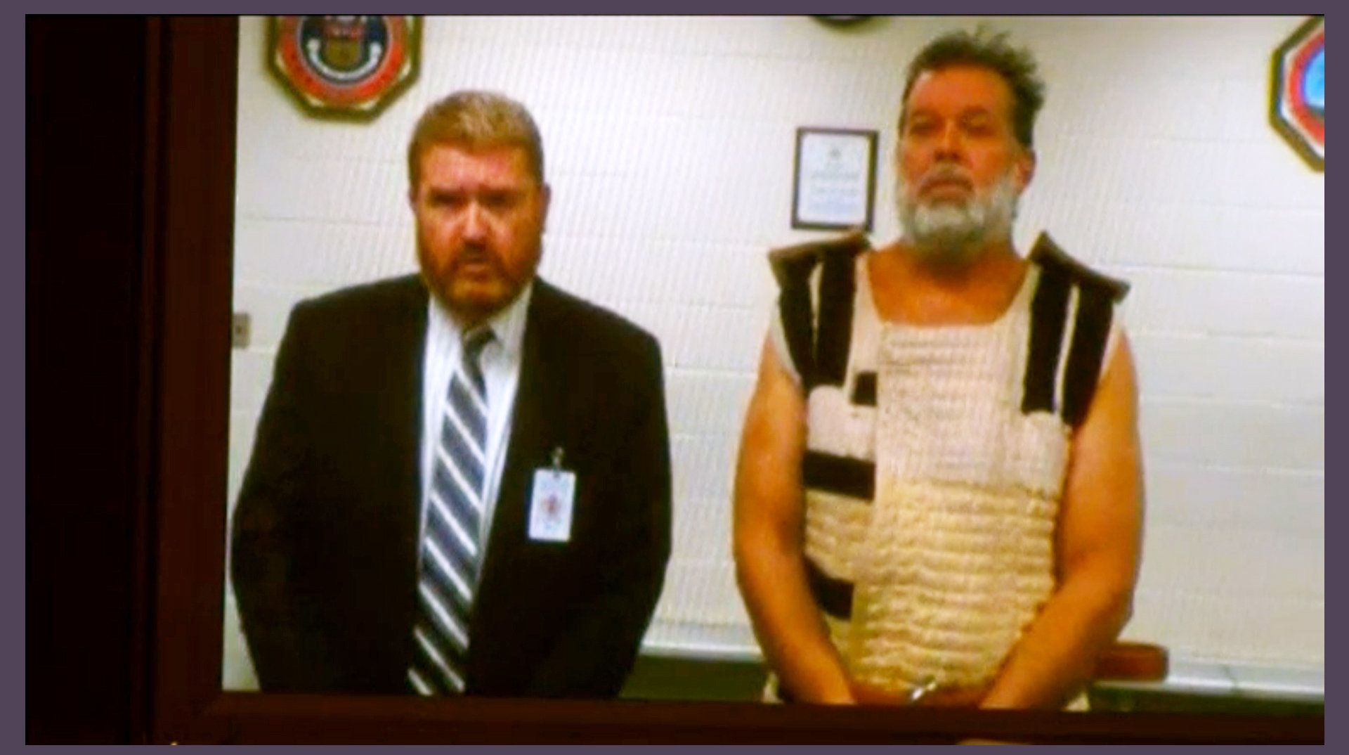 Accused Planned Parenthood gunman Robert Lewis Dear (R) appears in court with public defender Dan King by video link from jai