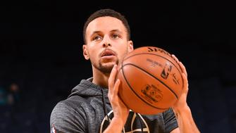 OAKLAND, CA - JANUARY 2:  Stephen Curry #30 of the Golden State Warriors warms up before the game against the Denver Nuggets on January 2, 2017 at ORACLE Arena in Oakland, California. NOTE TO USER: User expressly acknowledges and agrees that, by downloading and or using this photograph, user is consenting to the terms and conditions of Getty Images License Agreement. Mandatory Copyright Notice: Copyright 2017 NBAE (Photo by Noah Graham/NBAE via Getty Images)