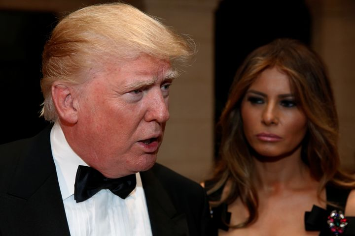 U.S. President-elect Donald Trump talks to reporters as he and his wife Melania Trump arrive for a New Year's Eve celebration
