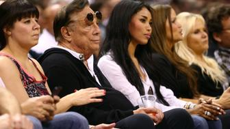 SAN ANTONIO, TX - MAY 19:  (2nd L) Team owner Donald Sterling of the Los Angeles Clippers and V. Stiviano watch the San Antonio Spurs play against the Memphis Grizzlies during Game One of the Western Conference Finals of the 2013 NBA Playoffs at AT&T Center on May 19, 2013 in San Antonio, Texas.  NOTE TO USER: User expressly acknowledges and agrees that, by downloading and or using this photograph, User is consenting to the terms and conditions of the Getty Images License Agreement.  (Photo by Ronald Martinez/Getty Images)