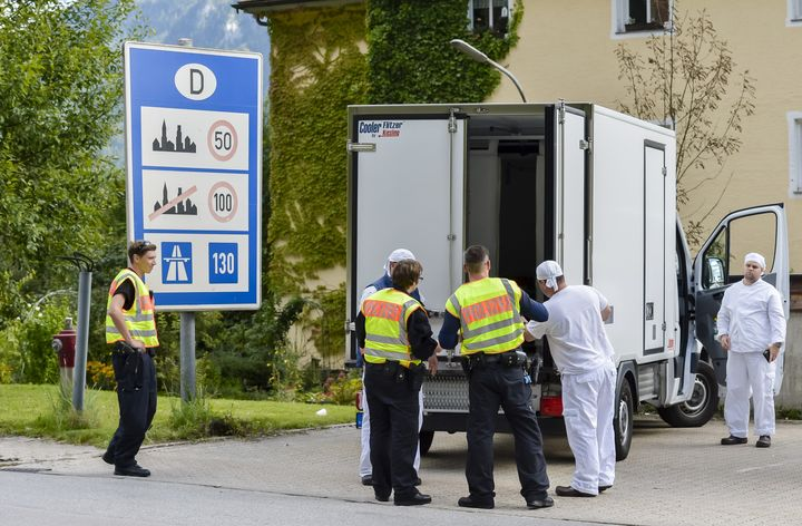 German police officers check a refrigerated truck at the check point during a border control on the border crossing between A