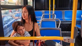 Mother On Bus, Bring Son To School.
