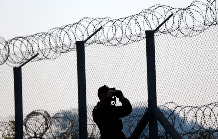 A Polish policeman patrols at the Hungary and Serbia border fence near the village of Asotthalom, Hungary, October 2, 2016.