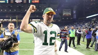 DETROIT, MI - JANUARY 01: Aaron Rodgers #12 of the Green Bay Packers celebrates a win over the Detroit Lions at Ford Field on January 1, 2017 in Detroit, Michigan. Green Bay defeated Detroit 31-24. (Photo by Leon Halip/Getty Images)