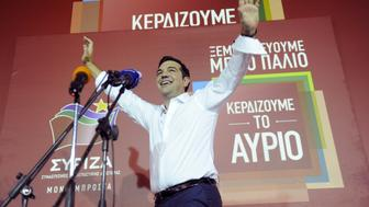 Former Greek prime minister and leader of leftist Syriza party Alexis Tsipras waves to supporters after winning the general election in Athens, Greece, September 20, 2015. Greek voters returned Tsipras to power with a strong election victory on Sunday, ensuring the charismatic leftist remains Greece's dominant political figure despite caving in to European demands for a bailout he once opposed. REUTERS/Michalis Karagiannis