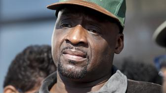 Floyd Dent takes part in a protest against police brutality outside the Inkster Police Department in Inkster, Michigan April 1, 2015. A judge on Wednesday entered a not guilty plea for Dent charged with drug possession who was dragged from his car, struck several times in the head and Tasered by suburban Detroit police during an arrest recorded on squad car video.    REUTERS/ Rebecca Cook