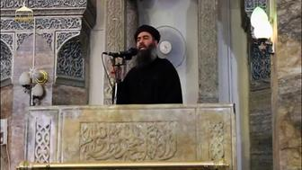 A man purported to be the reclusive leader of the militant Islamic State Abu Bakr al-Baghdadi has made what would be his first public appearance at a mosque in the centre of Iraq's second city, Mosul, according to a video recording posted on the Internet on July 5, 2014, in this still image taken from video. There had previously been reports on social media that Abu Bakr al-Baghdadi would make his first public appearance since his Islamic State in Iraq and the Levant (ISIL) changed its name to the Islamic State and declared him caliph. The Iraqi government denied that the video, which carried Friday's date, was credible. It was also not possible to immediately confirm the authenticity of the recording or the date when it was made. REUTERS/Social Media Website via Reuters TV (IRAQ - Tags: POLITICS) ATTENTION EDITORS - THIS IMAGE HAS BEEN SUPPLIED BY A THIRD PARTY. IT IS DISTRIBUTED, EXACTLY AS RECEIVED BY REUTERS, AS A SERVICE TO CLIENTS. REUTERS IS UNABLE TO INDEPENDENTLY VERIFY THE CONTENT OF THIS VIDEO, WHICH HAS BEEN OBTAINED FROM A SOCIAL MEDIA WEBSITE