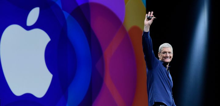 Tim Cook waves before speaking during the Apple World Wide Developers Conference (WWDC) in San Francisco, California, U.S., o