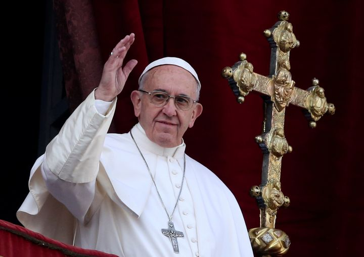 """Pope Francis waves after delivering his """"Urbi et Orbi"""" (to the city and the world) message from the balcony overlooking St. P"""