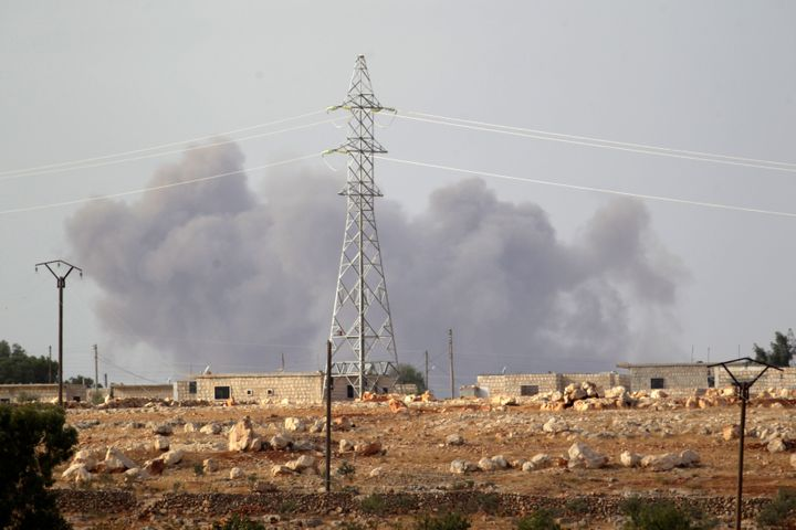 Smoke rises after what activists said were Russian airstrikes in the southern Idlib province, Syria October 2, 2015.
