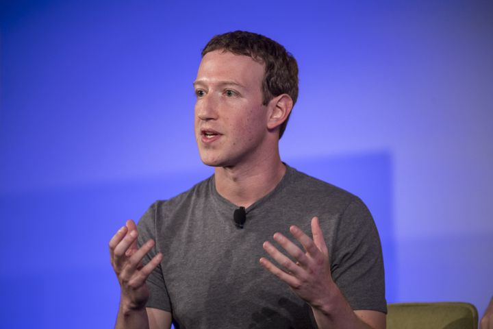 Mark Zuckerberg, chief executive officer and founder of Facebook Inc., gestures as he speaks during a session at the Techonom