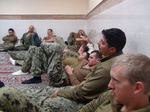 An undated picture released by Iran's Revolutionary Guards website shows American sailors sitting in an unknown place in Iran