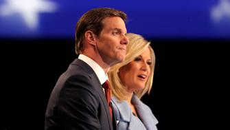 Fox News anchors and debate moderators Bill Hemmer (L) and Martha MacCallum preside over a forum for the lower polling candidates held by Fox News before the U.S. Republican presidential candidates debate in Des Moines, Iowa January 28, 2016. REUTERS/Jim Young