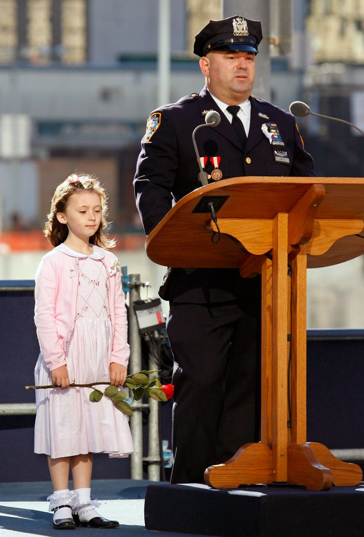 New York City policeman James Smith is seen beside his 7-year-old daughter, Patricia Smith, during the fifth anniversary of t