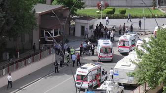 Ambulances are parked outside the police headquarters in the southeastern Turkish city of Gaziantep on May 1, 2016 after a bomb exploded, killing one police officer.   A bomb exploded on May 1 outside police headquarters in the southeastern Turkish city of Gaziantep close to the Syrian border, killing one police officer and wounding 13 other people, the local governor said. Gaziantep regional governor Ali Yerlikaya was quoted by Turkish media as saying nine of those wounded were police. NTV television said the explosion was caused by a car bomb and had been followed by sounds of gunfire.  / AFP / ILHAS NEWS AGENCY / - / Turkey OUT        (Photo credit should read -/AFP/Getty Images)