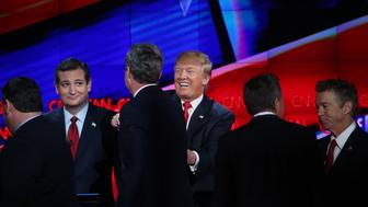 LAS VEGAS, NV - DECEMBER 15:  Republican presidential candidate Donald Trump smiles (C) as New Jersey Gov. Chris Christie (L), Jeb Bush (2ndL), Ohio Gov. John Kasich (2nd R) and U.S. Sen. Rand Paul (R-KY) walk onstage afterthe CNN Republican presidential debate on December 15, 2015 in Las Vegas, Nevada. This is the last GOP debate of the year, with U.S. Sen. Ted Cruz (R-TX) gaining in the polls in Iowa and other early voting states and Donald Trump rising in national polls.  (Photo by Justin Sullivan/Getty Images)