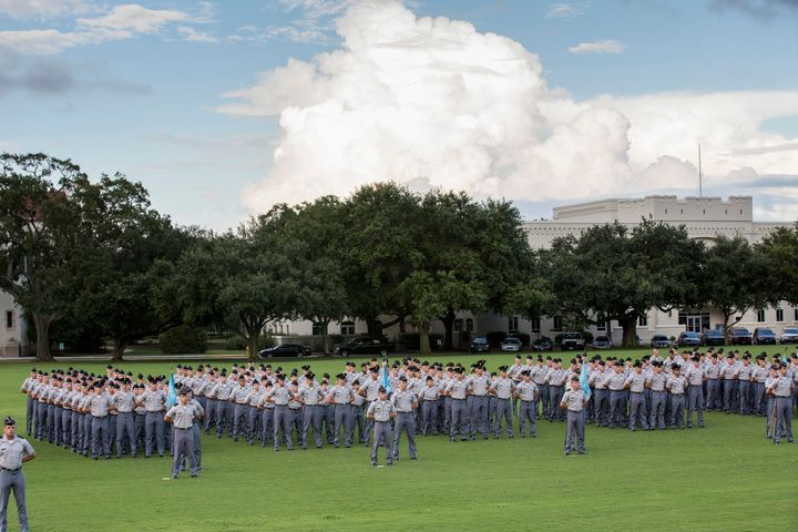 Citadel freshman cadets, known as knobs, stand in formation during the oath ceremony on August 19, 2013 in Charleston, South