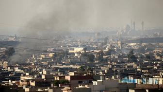 Smoke rises from clashes during a battle with Islamic State militants in the Mithaq district of eastern Mosul, Iraq, January 3, 2017.  REUTERS/Thaier Al-Sudani