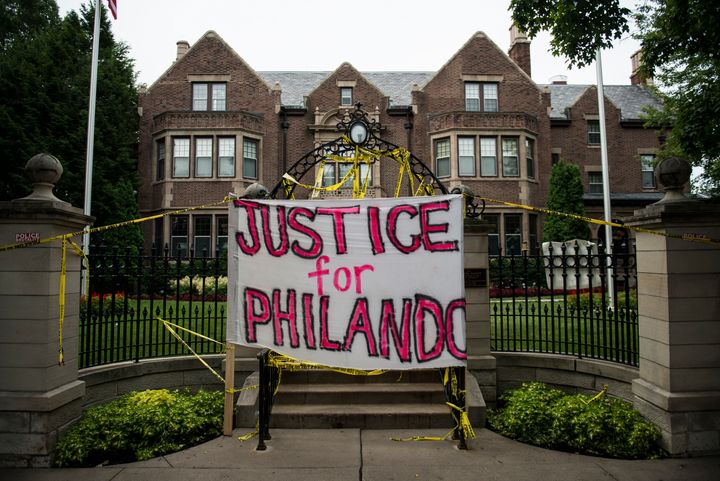 A sign reading, 'Justice for Philando,' and police tape are draped over the entrance of the Governor's Mansion following the