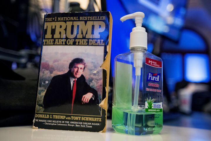 'The Art Of The Deal' by U.S. President-elect Donald Trump is displayed on top of a desk on the floor of the New York Stock E