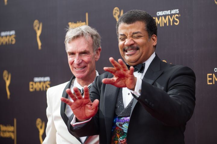 Bill Nye (L) and Neil deGrasse Tyson arrive at the Creative Arts Emmy Awards at Microsoft Theater on September 10, 2016 in Lo