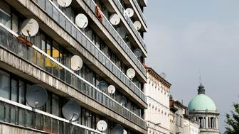 Television satellite dishes are pictured on an apartment building in the Brussels district of Molenbeek, Belgium, August 14, 2016.  REUTERS/Francois Lenoir