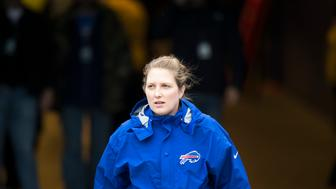 ORCHARD PARK, NY - OCTOBER 30:  Kathryn Smith Buffalo Bills Quality Control-Special Teams enters the field for warm ups before the game against the New England Patriots on October 30, 2016 at New Era Field in Orchard Park, New York. New England defeats Buffalo 41-25.  (Photo by Brett Carlsen/Getty Images)