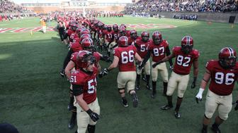 Harvard players enter the field of play before the Harvard Vs Yale, College Football, Ivy League deciding game, Harvard Stadium, Boston, Massachusetts, USA. 22nd November 2014. Photo Tim Clayton (Photo by Tim Clayton/Corbis via Getty Images)