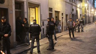 Police officers investigate on January 9, 2016 outside the building that houses the flat of Ashley Olsen, a 35-year-old American expatriate artist who was found dead on January 9, in the center Florence.  Italian police were today studying cc-tv footage and awaiting the result of an autopsy as they attempted to explain the mysterious slaying of an American woman in Florence. Expatriate Ashley Olsen, an artist and event organiser who had moved to the Tuscan city to be near her art teacher father, was found dead in her flat in the city centre on January 9.   / AFP / CLAUDIO GIOVANNINI        (Photo credit should read CLAUDIO GIOVANNINI/AFP/Getty Images)