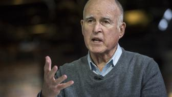 Jerry Brown, governor of California, speaks during a Bloomberg Television interview in San Francisco, California, U.S., on Thursday, March 3, 2016. Brown said Republican presidential front-runner Donald Trump's idea to build a wall to prevent migrants from crossing the southern U.S. border and have Mexico pay for it is 'absolutely preposterous.' Photographer: David Paul Morris/Bloomberg via Getty Images