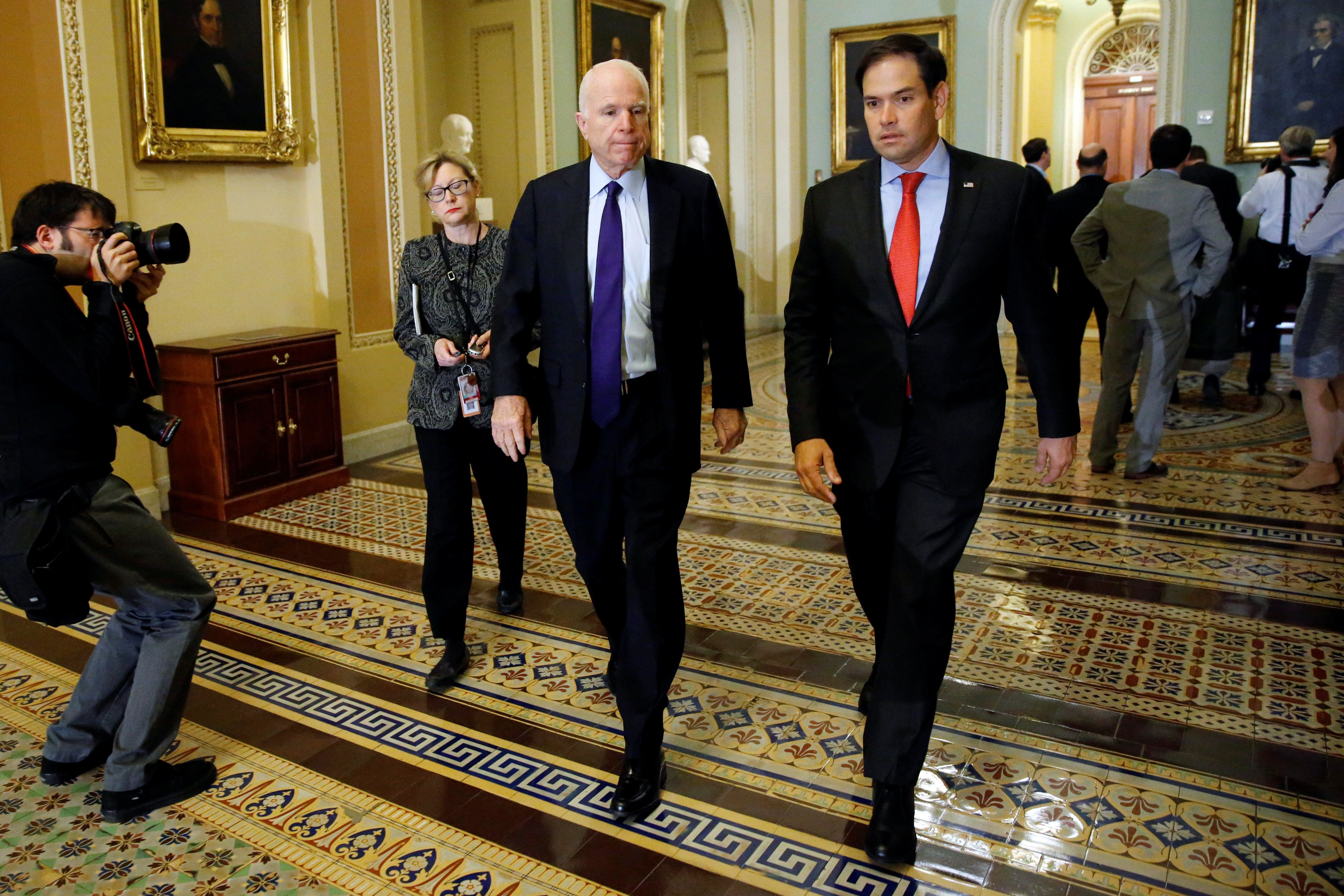U.S. Senator John McCain (R-AZ) (2nd R) and Senator Marco Rubio (R-FL) (R) arrive for Senate Republican party leadership elections at the U.S. Capitol in Washington, DC, U.S. November 16, 2016. REUTERS/Jonathan Ernst