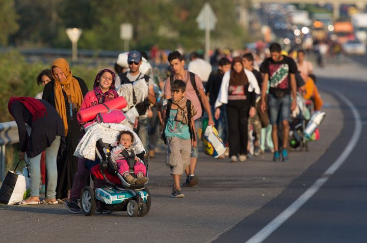 Migrants begin walking towards the Austrian border on September 4, 2015 in Bicske, near Budapest, Hungary.