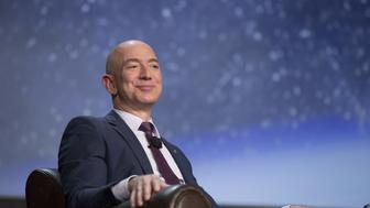 Jeff Bezos, chief executive officer of Amazon.com Inc. and founder of Blue Origin LLC, smiles during the 32nd Space Symposium in Colorado Springs, Colorado, U.S., on Tuesday, April 12, 2016. Commercial space exploration can advance at the fast pace of Internet commerce only if the cost is reduced through advances in reusable rockets, Bezos said. Photographer: Matthew Staver/Bloomberg via Getty Images