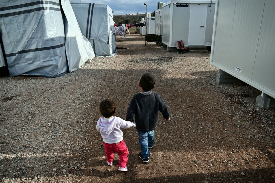 Children walk at the Ritsona refugee camp, north of Athens, on December 21,