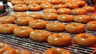 Krispy Kreme doughnuts go into production at the opening of the store at Harrods in London, October, 3, 2003. The U.S. chain opened its first European outlet in London on Friday. CPROD REUTERS/ David Bebber  ASA/thi