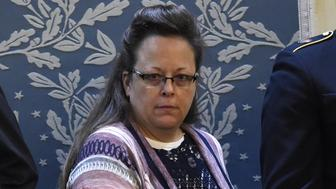 Kim Davis, the Rowan County clerk in Kentucky, arrives before US President Barack Obama delivers the State of the Union Address during a Joint Session of Congress at the US Capitol in Washington, DC, January 12, 2016. Kim Davis, a born-again Christian, was jailed briefly in September 2015 for contempt of court after refusing to issue marriage  licenses due to her opposition to gay marriage, which the Supreme Court legalized across the United States in June. Barack Obama will give his final State of the Union address, perhaps the last big opportunity of his presidency to sway a national audience and frame the 2016 election race. AFP PHOTO / SAUL LOEB / AFP / SAUL LOEB        (Photo credit should read SAUL LOEB/AFP/Getty Images)