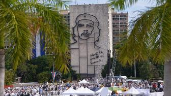 People gather at Revolution Square for Pope Francis's mass on September 20, 2015. Pope Francis greeted massive crowds of fans and Catholic faithful Sunday as he arrived in his popemobile to give mass on Havana's iconic Revolution Square, the highlight of his trip to Cuba. Across from the square is a portrait of revolutionary leader Ernesto 'Che' Guevara on the front of the Interior Ministry building.    AFP PHOTO / FILIPPO MONTEFORTE        (Photo credit should read FILIPPO MONTEFORTE/AFP/Getty Images)